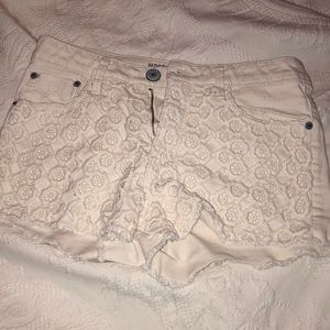 Cream shorts with floral embroidery